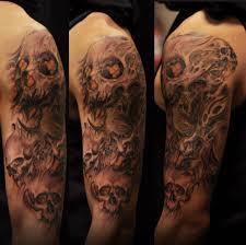 hannya mask tattoo black and grey half sleeve black and grey colour hannya mask and skulls tattoo