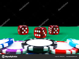 poker game table set a set of poker chips stack on a green game table with a dice rolls