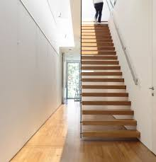 inside of a stylish home in singapore view in gallery wooden staircase in the singapore home