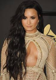 demi lovato earrings grammys demi lovato in see through dress and giuseppe zanotti sandals