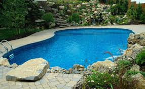 destination swimming pool deck and patio design builds backyard oasis