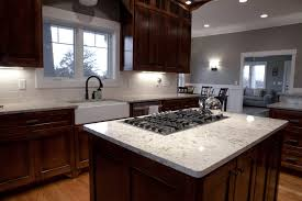 kitchen island with cooktop and oven transitional islands dark brown varnished wood kitchen cabinet aura polished silestone quartz countertop black faucet white sink wall storage bar island
