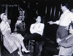 elvis with singer pat boone up with the white shirt on the set