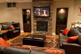 basement modern home interior design with fireplace and ottoman
