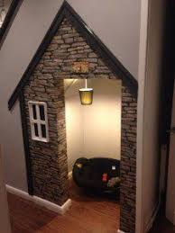 secret bookcase door under stairs http www stashvault com how to