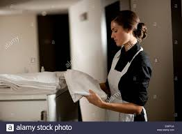 House Keeping by Maid With Housekeeping Cart Stock Photo Royalty Free Image