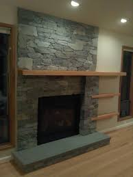living room stone chimney supercast concrete mantel shelf black