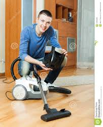Vacuuming Guy Vacuuming With Vacuum Cleaner On Parquet Floor In Living Roo