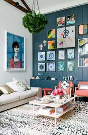 vintage gallery wall with multi colored frames for small living