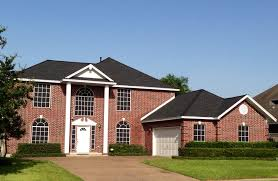 exterior design exciting versetta stone with dark garage door and awesome brick wall with paint front door and gaf timberline shingles plus white garage door for