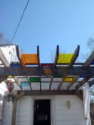 pergola over my deck with colored plexiglass to create stained