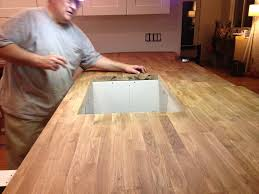 furniture installation of butcher block countertops on a kitchen