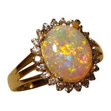 crystal opal rings images Oval crystal opal diamond halo ring 14k gold opal ring flashopal jpg