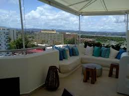 The Beach House Hotel Isla Verde - eating lounging area near bar by rooftop pool picture of san