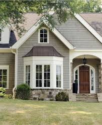color of tin roof and color for front door want garage door this color of bay window roof house body and trim front door could match bay window roof