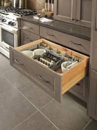 wide drawers with portable inserts by kitchen craft add simplicity