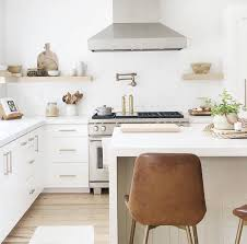 white kitchen cabinets with gold pulls is gold cabinet hardware trendy caroline on design