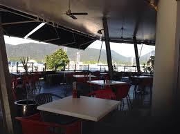 view across wraparound deck to pier marina across trinity inlet