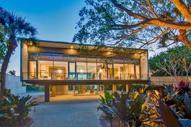 tour an elevated modern glass house in osprey florida modern