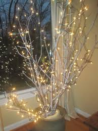 christmas branches with lights light in the window and hygge in the home hygge goinghome light