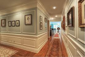 traditional hallway with crown molding u0026 chair rail in