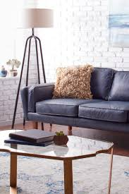 Living Room With Blue Sofa by How To Decorate With A Blue Sofa Overstock Com