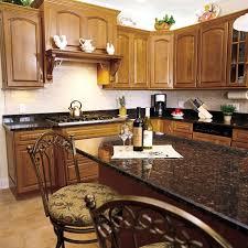 how to cut ceramic tile around kitchen cabinets backsplash bonanza this house