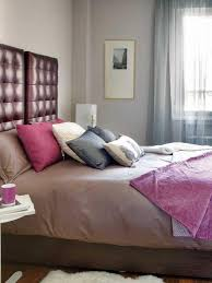 small kids bedroom design brown wooden bed frame pink fabric