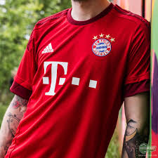 the new bayern munich home shirt dons the famous red colour once more