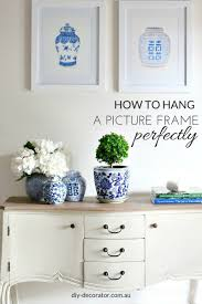 Hanging A Frame by How To Hang A Picture Frame Perfectly Diy Decorator