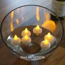 floating led tea lights coin battery 12pcs romantic yellow flicker floating led tea lights