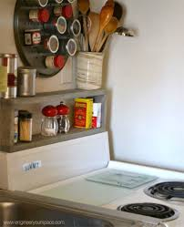 12 space saving hacks for your tight kitchen hometalk add a simple shelf above your stove