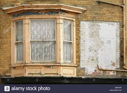old wooden sash bay window in need of restoration stock photo