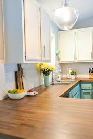 how to install butcher block countertops hey let s make stuff we totally transformed our dated 1980 s kitchen with bright painted cabinets new lighting and