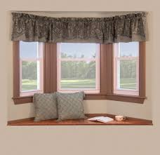 bay window with clever window curtain ideas has small hanging curtain on top