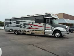 renegade 2412ag motorhome with 12 u0027 garage flying a motorsports