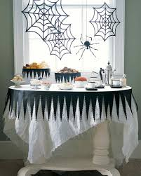 tattered halloween tablecloth and spiderweb decor martha stewart