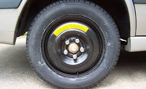 camaro flat tire how far can you drive on a spare tire autoguide com