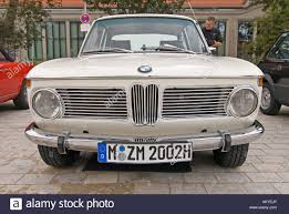 bmw vintage coupe front of bmw 2002 with special number plate for vintage cars stock
