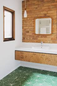best 20 mid century bathroom ideas on pinterest mid century light wood floating bathroom vanity with exposed brick and green tile floor modern meets natural bathroom design how nest architects looked at