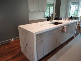 statuarettio marble waterfall countertops calcutta carrera grey