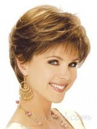 feathered back hairstyles light blonde mixed spiffy short inclined bang shaggy natural wavy