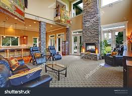 luxury house open floor plan spacious stock photo 203200153 luxury house open floor plan spacious living room with high ceiling brick columns and