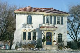 spanish mission style white exterior stucco new stucco house