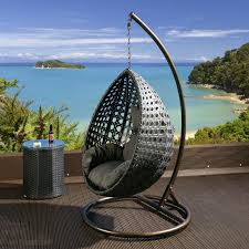 black rattan hanging chair with grey cushion covers hanging