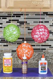all you need is yarn glue and balloons to make these eye catching