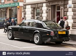 black rolls royce focus of attention sleek black rolls royce saloon car in