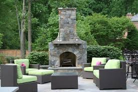 flagstone patio with fieldstone fireplace and seat wall land art