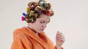 face of teenage girl of 13 years old wearing bathrobe in hair