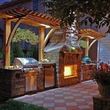 diamond printed patio with wooden pergola for chic outdoor kitchen